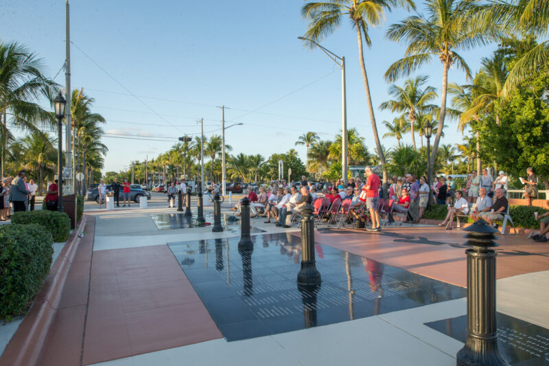 Visitors and loved in the beautiful tropical setting at the Key West AIDS Memorial.